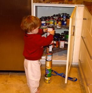 Child with autism stacking cans. Courtesy Wikimedia.